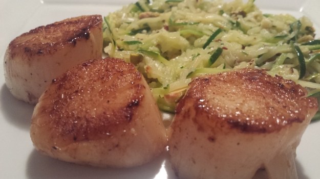 Seared scallops with zucchini pasta